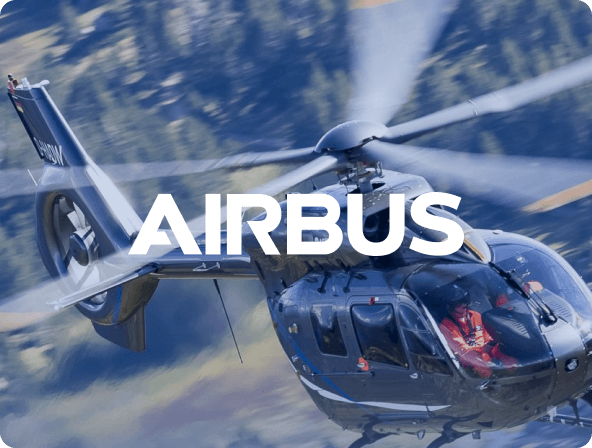 close up action shot of helicopter flying with airbus logo overlay